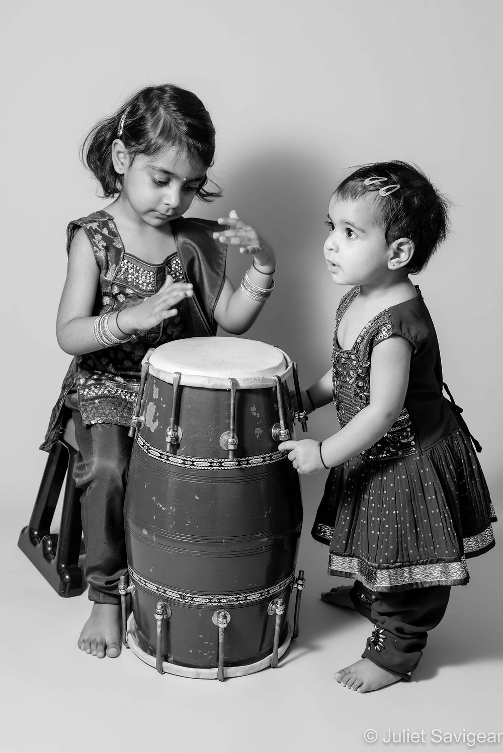 Children playing the Indian drum