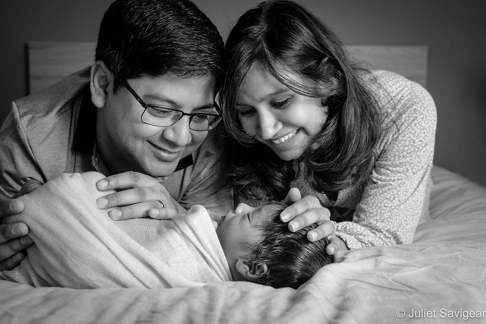 Natural family portrait with newborn baby