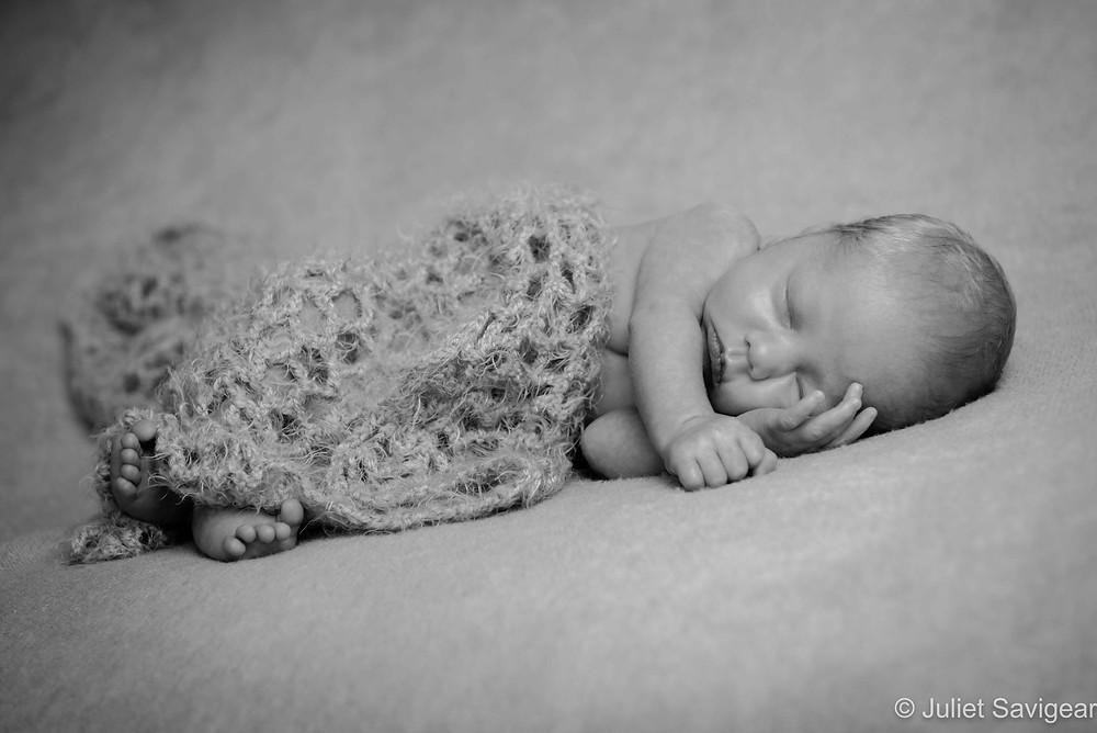 Baby sleeping on blanket