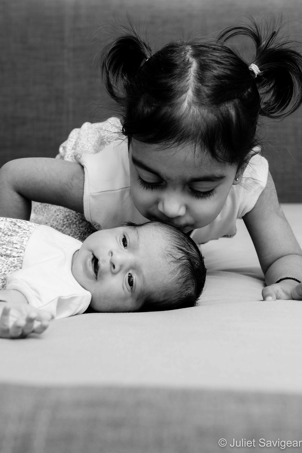 Kisses for baby sister