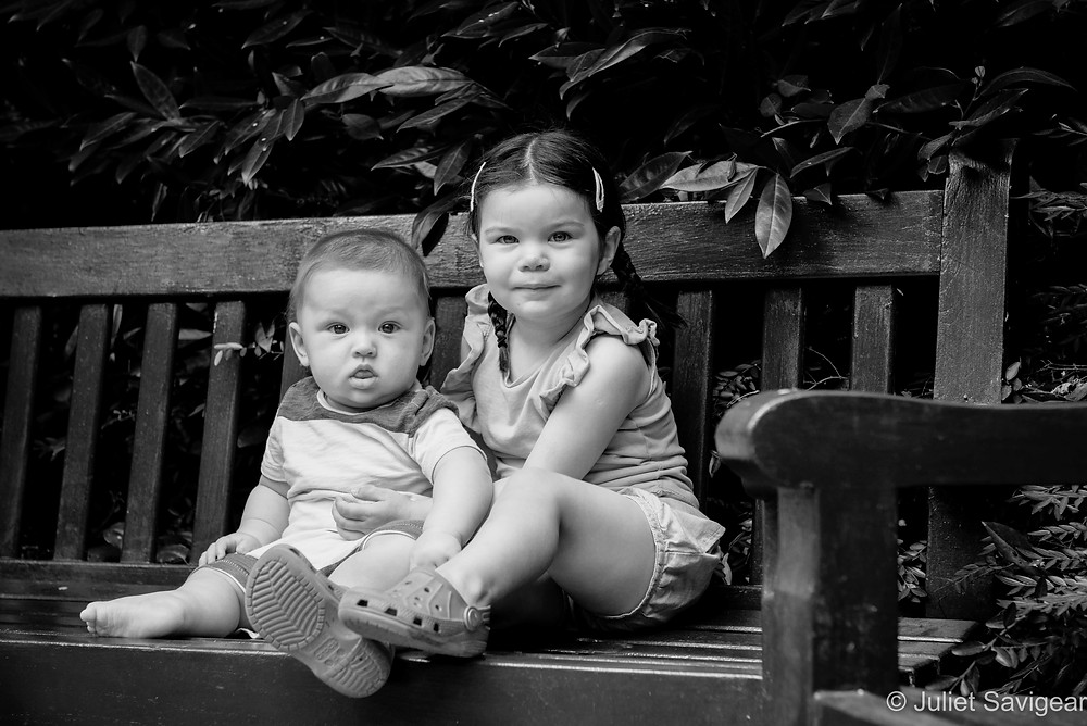 Cousins sat on park bench