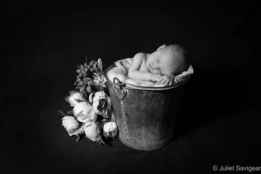 Newborn baby photography with props
