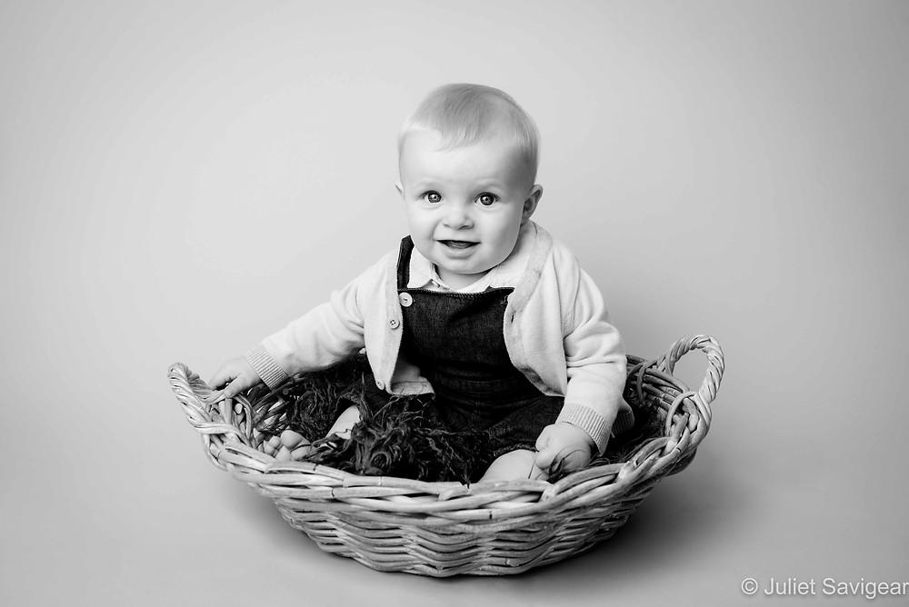 Baby boy in basket