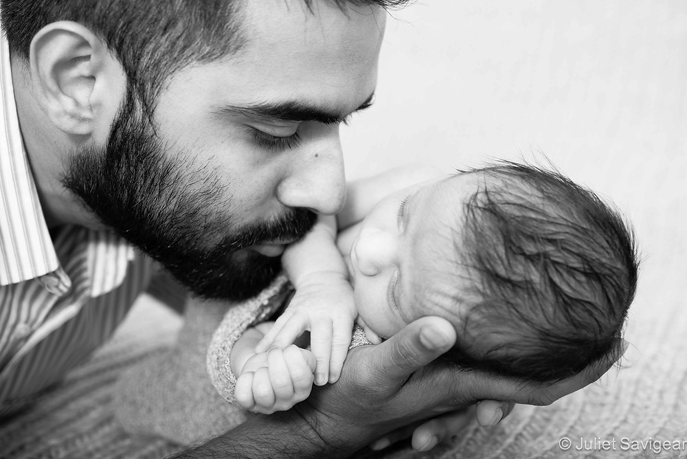 Father with newborn baby son