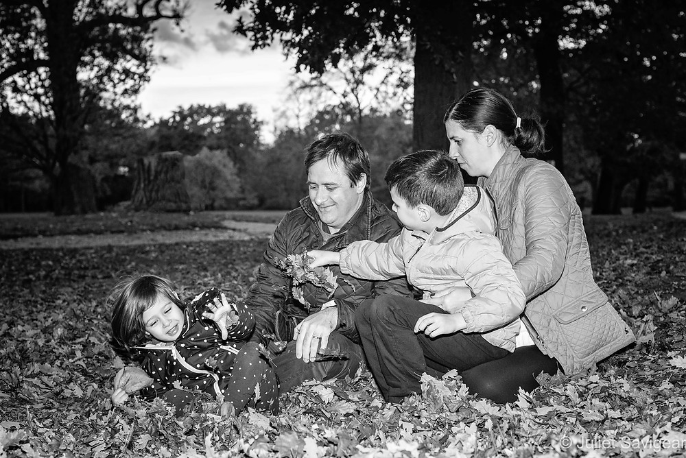 Family playing in the leaves