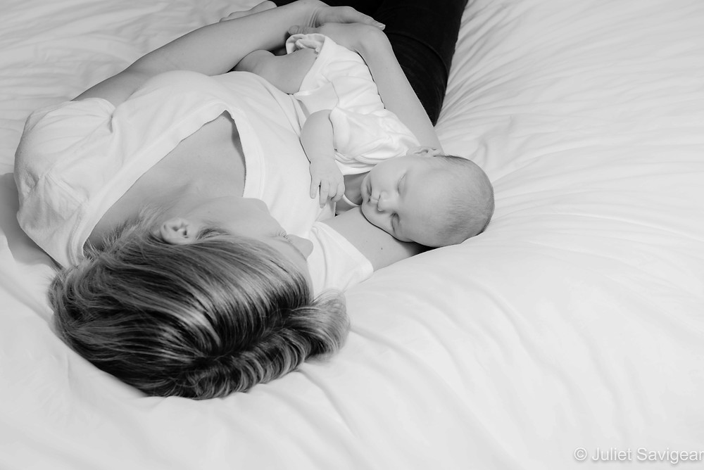 Mother and baby on bed