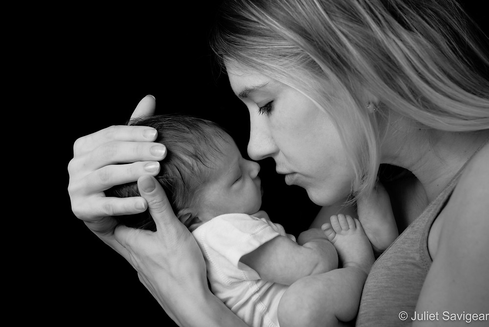 Mother with newborn baby girl