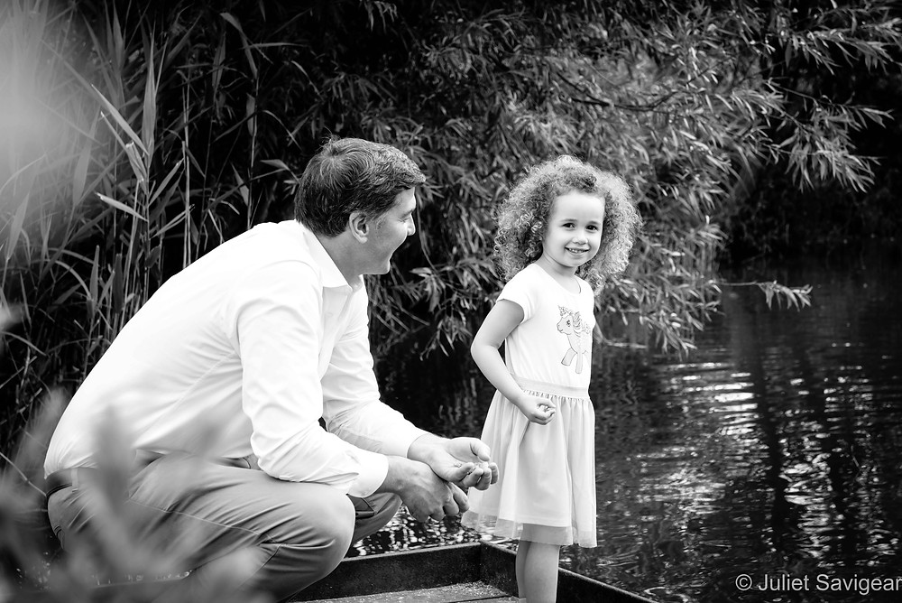 Father & daughter by the pond