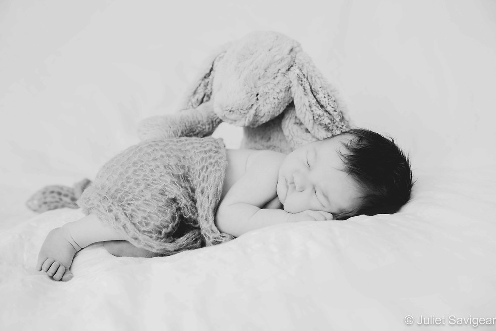 Sleeping baby with toy rabbit