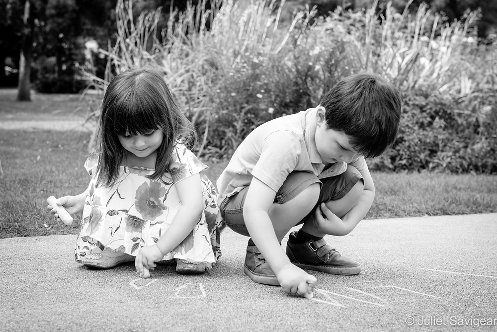 Children playing with chalks in the park