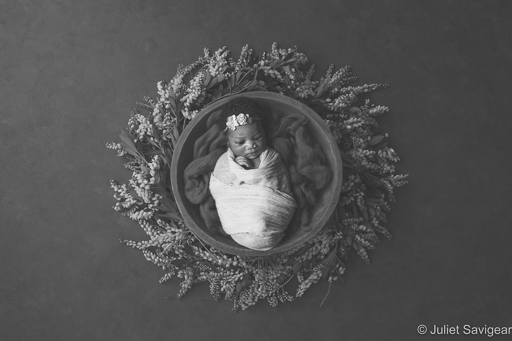 Baby in flower wreath