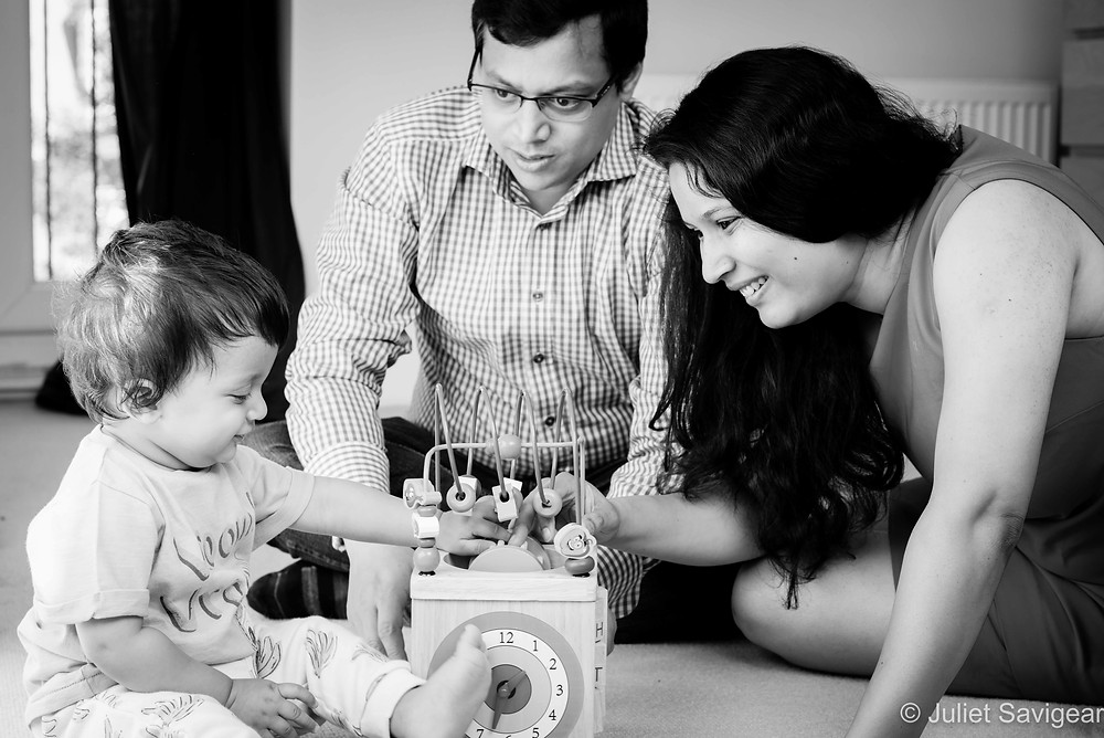 Family playing with their baby