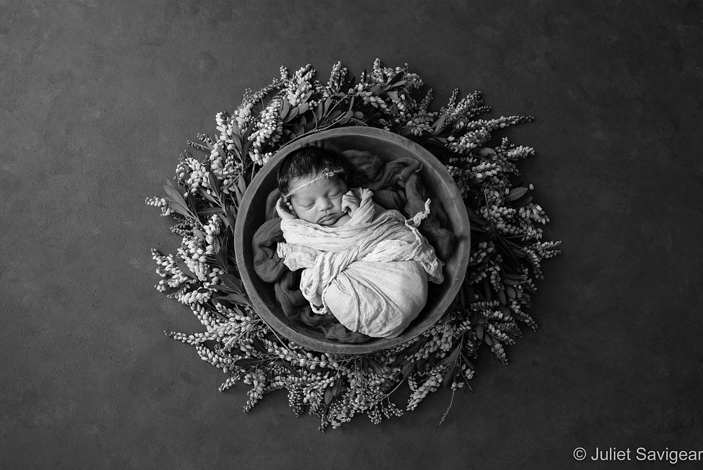 Baby girl in beautiful wreath