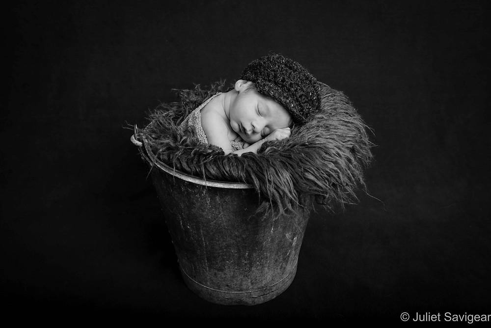 Baby Sleeping In A Bucket