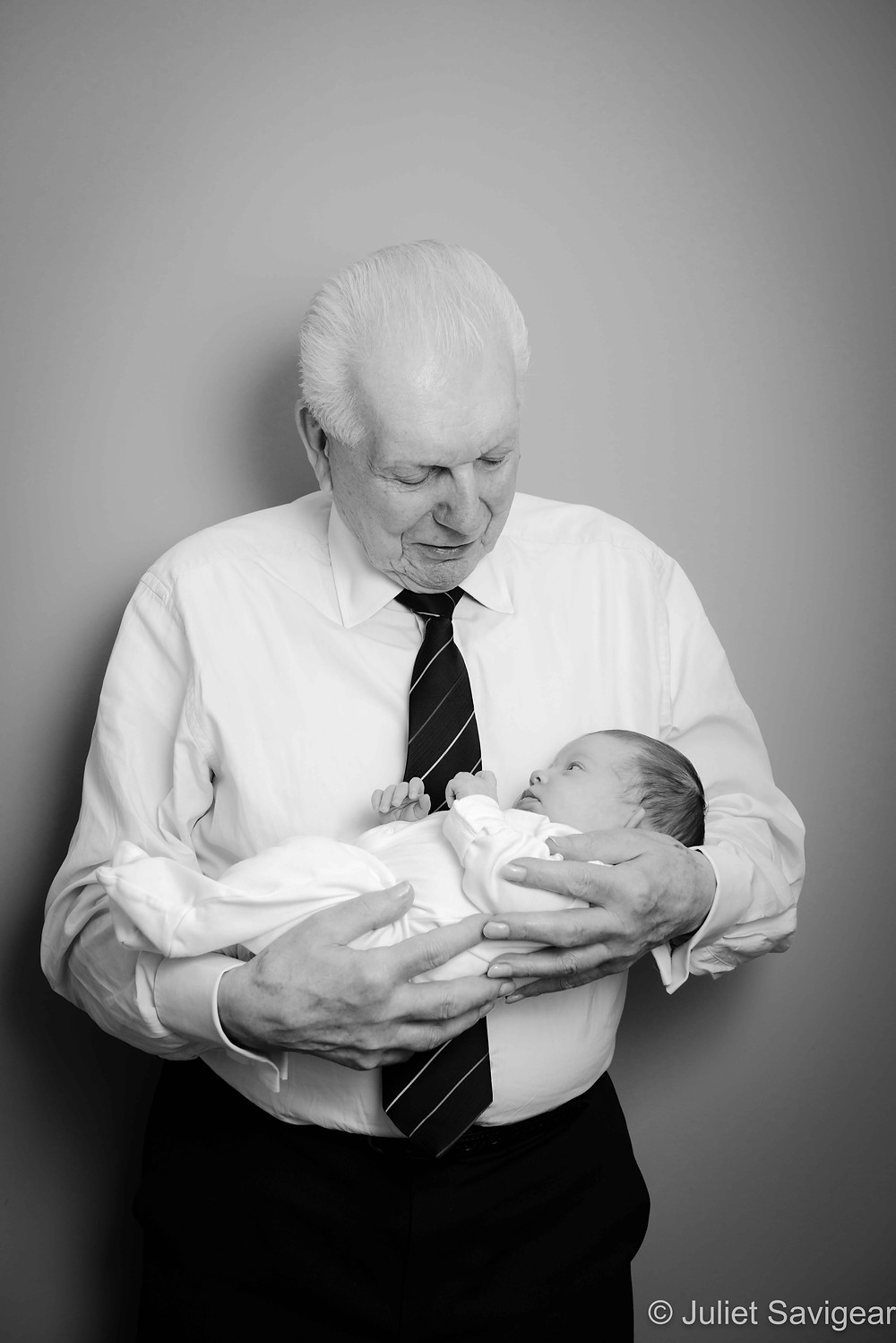 Baby In Grandpa's Arms