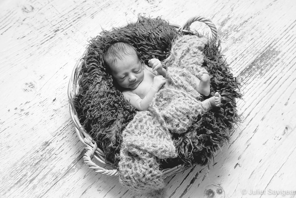 Newborn baby in a basket
