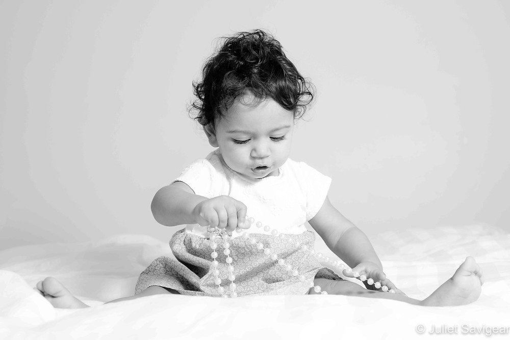 Baby with bead necklace