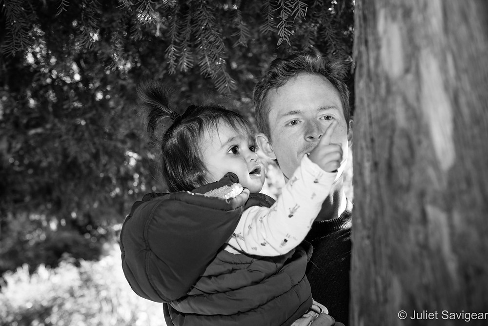Father and daughter under tree