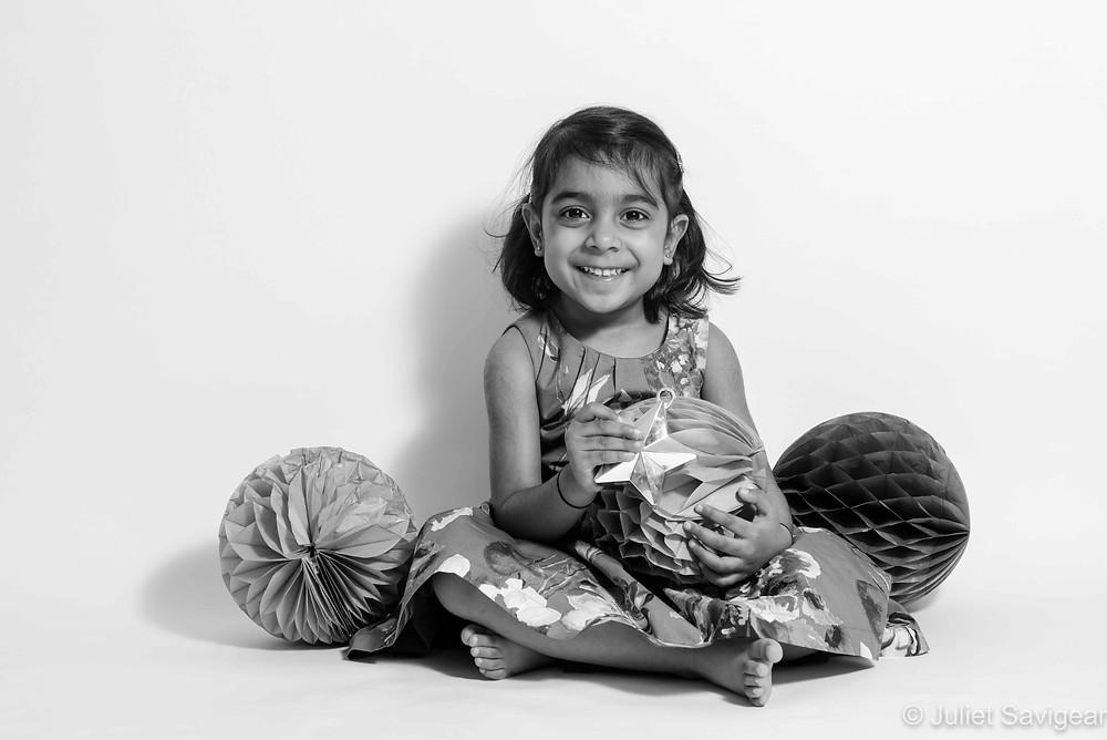 Child with pom poms