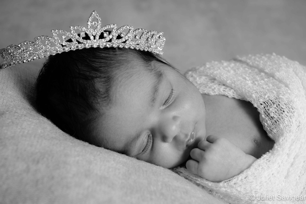 Newborn baby with tiara