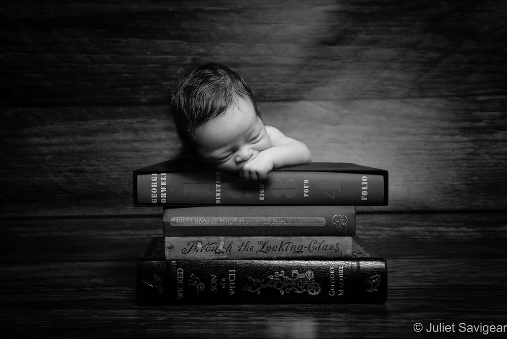 Baby on books