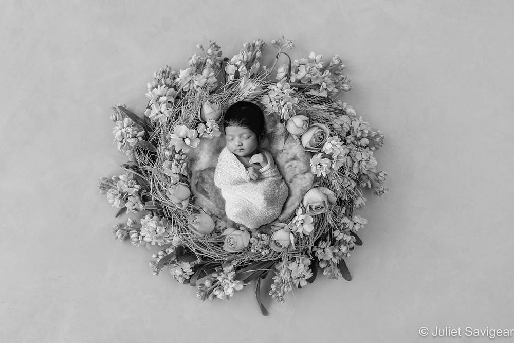 Baby in floral wreath