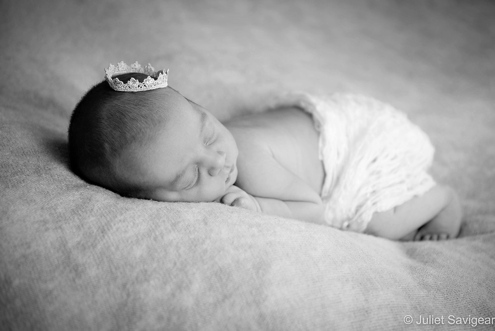 Newborn baby girl with crown