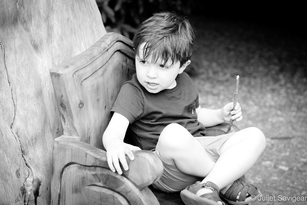 Boy on wooden throne