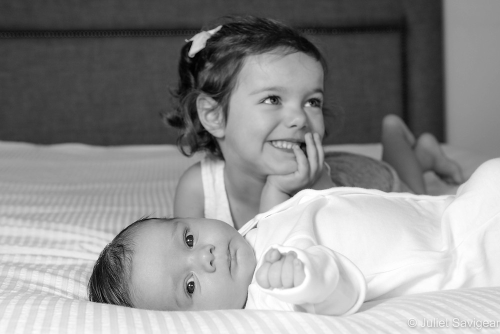 Proud big sister with baby brother
