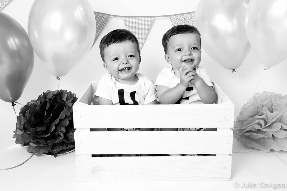 Twin boys in wooden crate