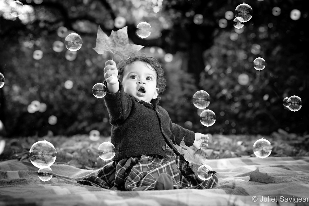 Baby with bubbles in the garden