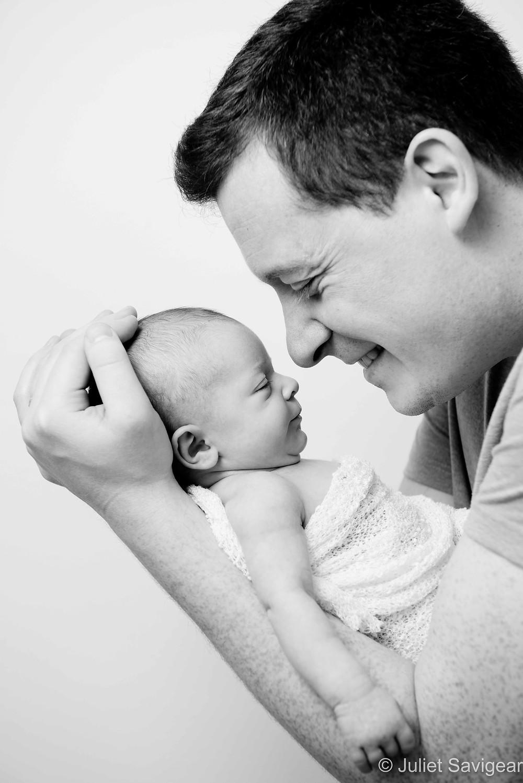 Daddy and newborn baby
