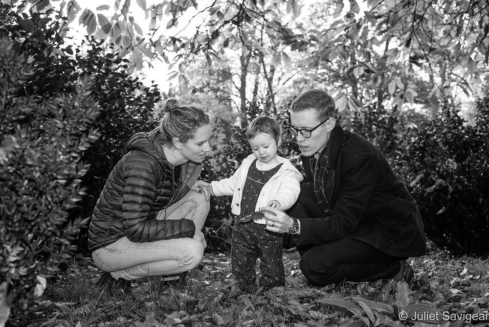 Family looking at leaves