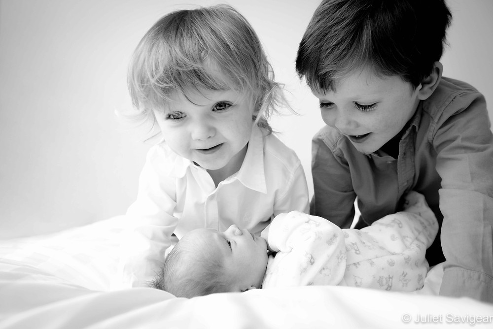 Brothers with newborn baby