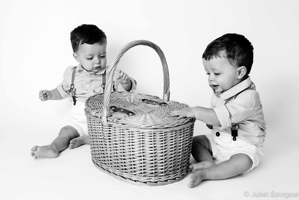 Twin boys with basket