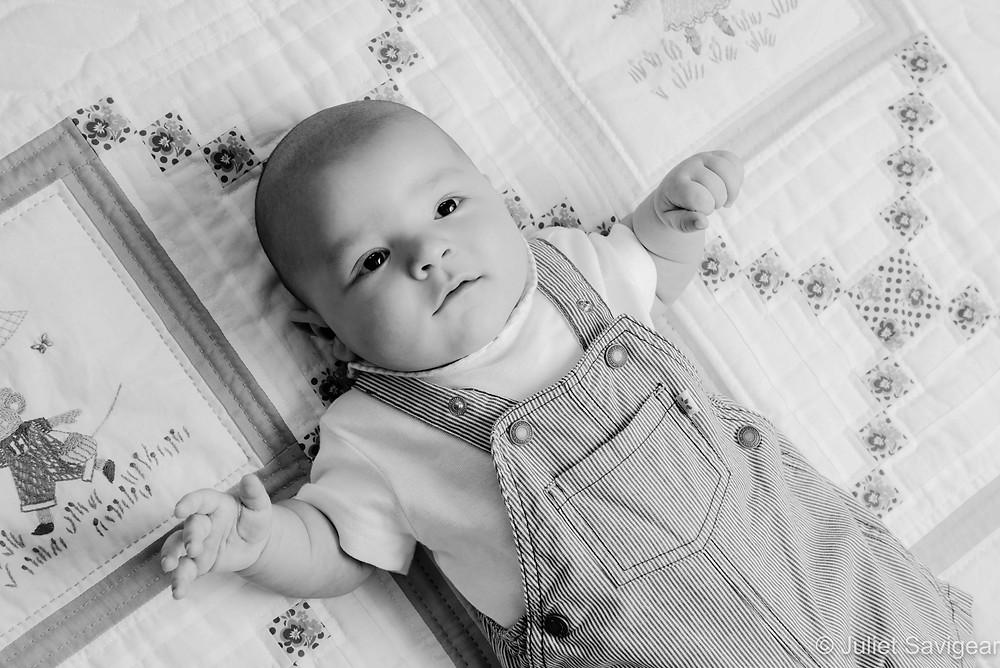 Baby On Handmade Quilt