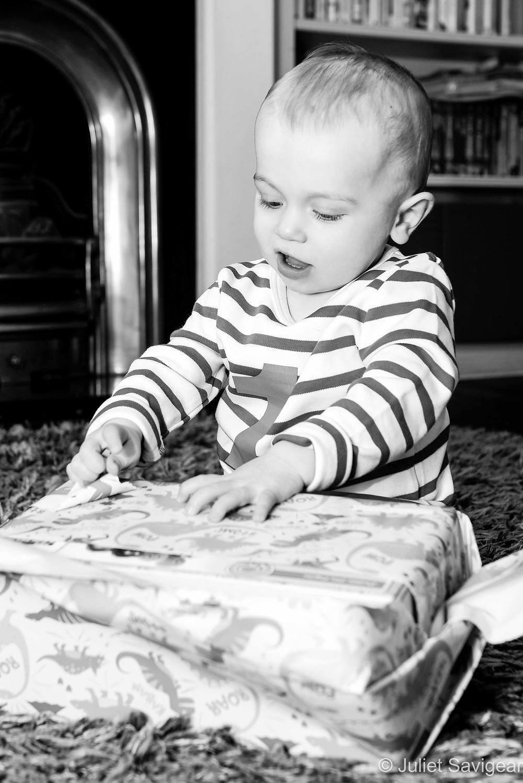 Baby opening birthday presents