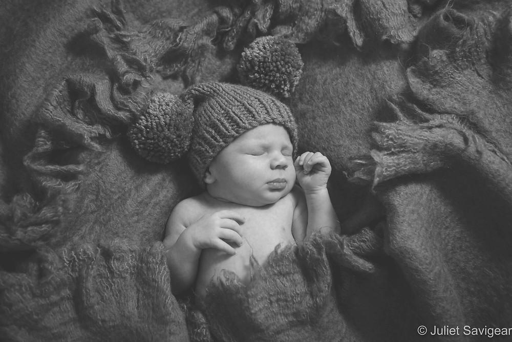 Baby boy in pom pom hat
