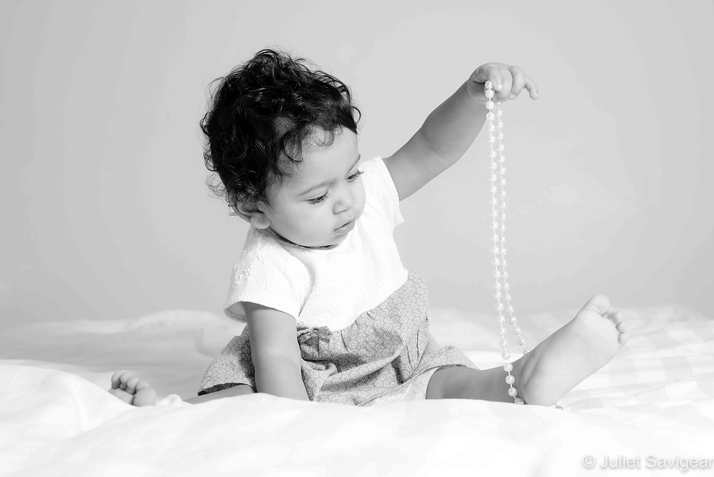 baby with beads