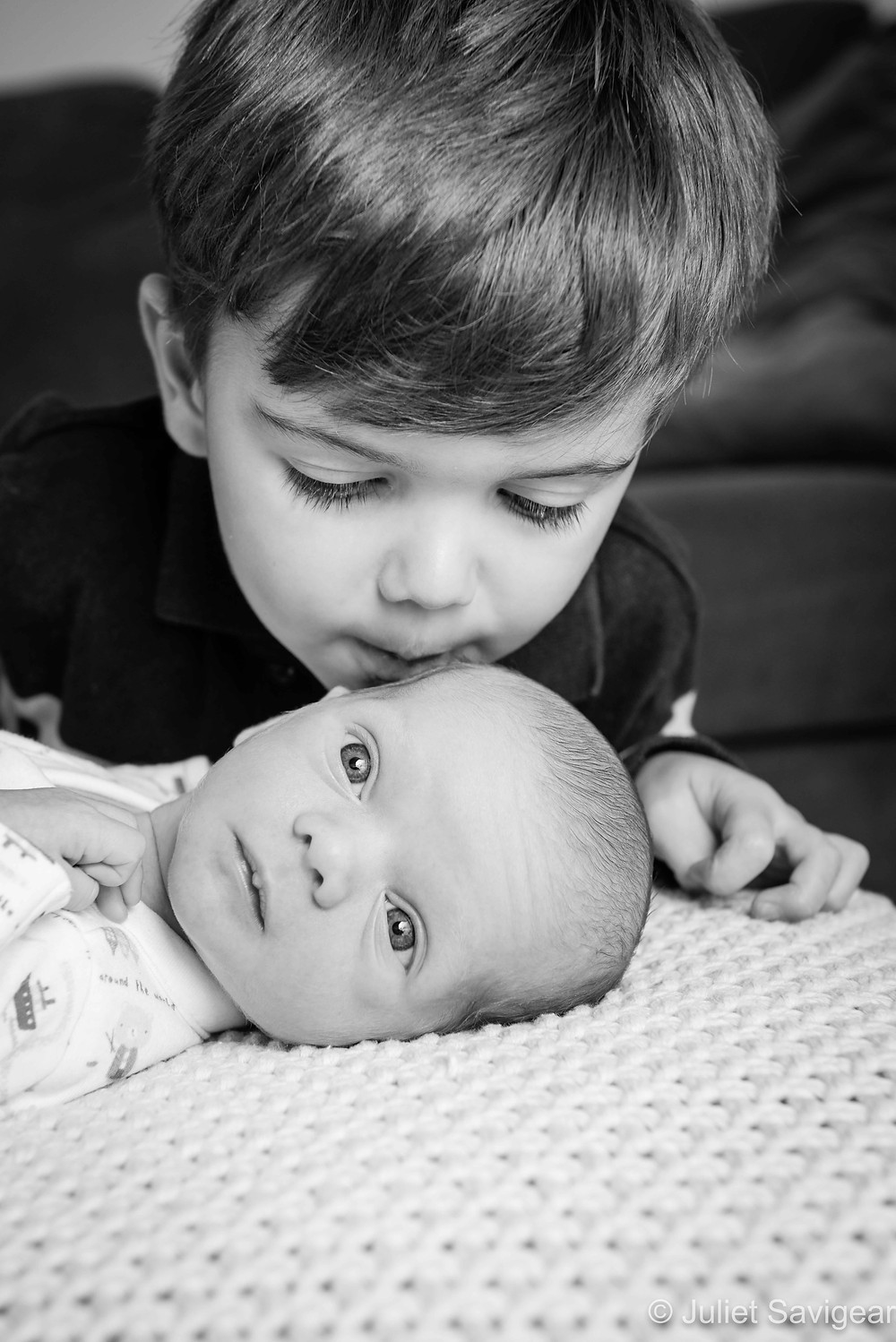 Brother's kiss for baby
