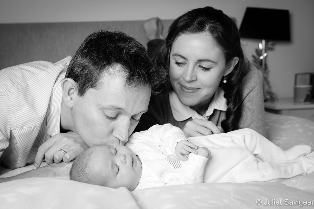 Mummy and daddy with sleeping baby