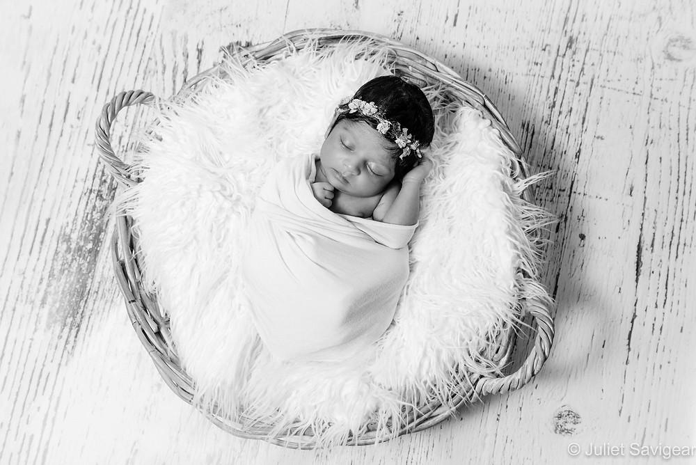 Newborn baby girl in basket