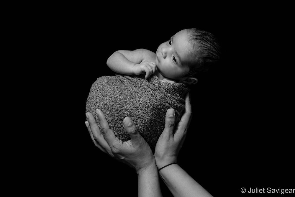 Baby in mother's hands