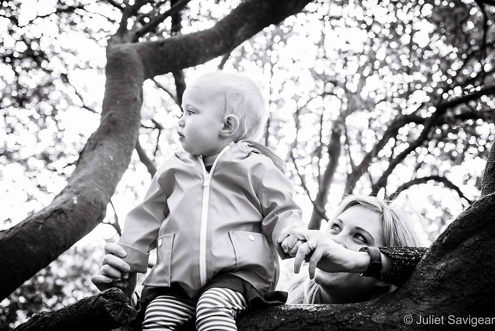 Toddler Sitting On Branch