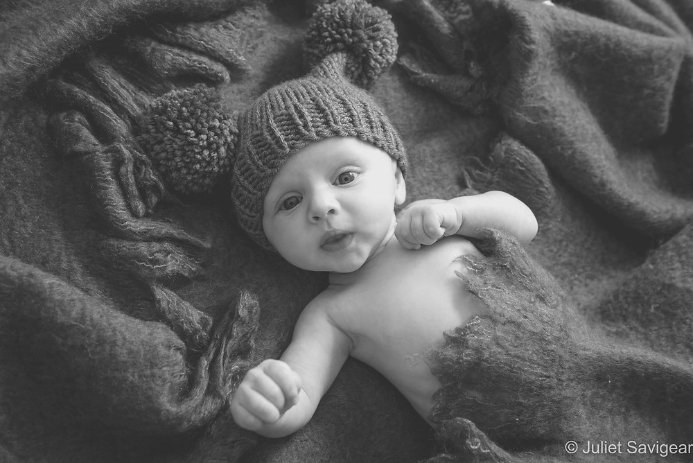 Baby boy in cosy pom pom hat