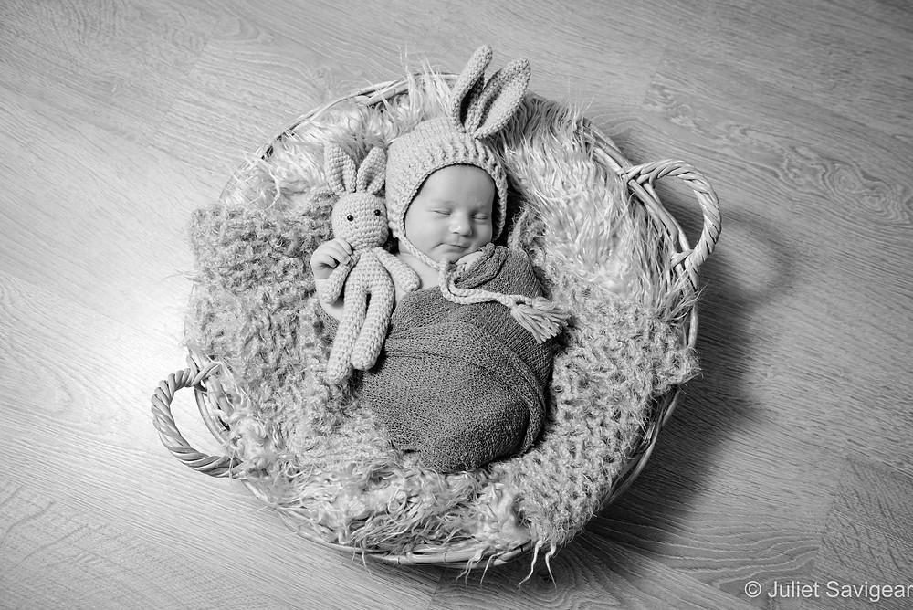 Baby in bunny hat in basket