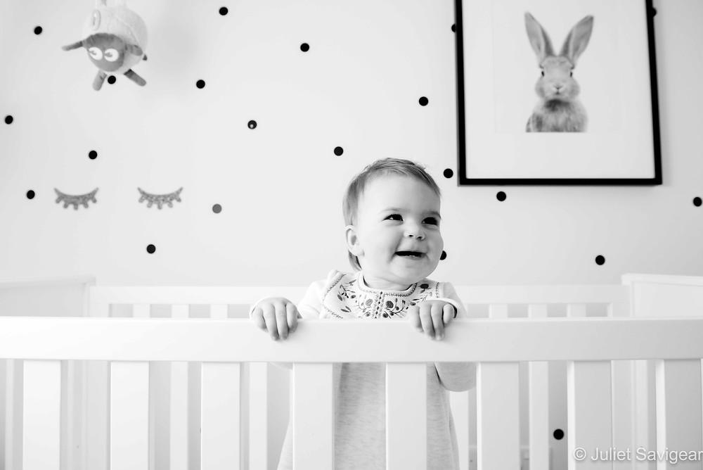 Baby dancing in her cot