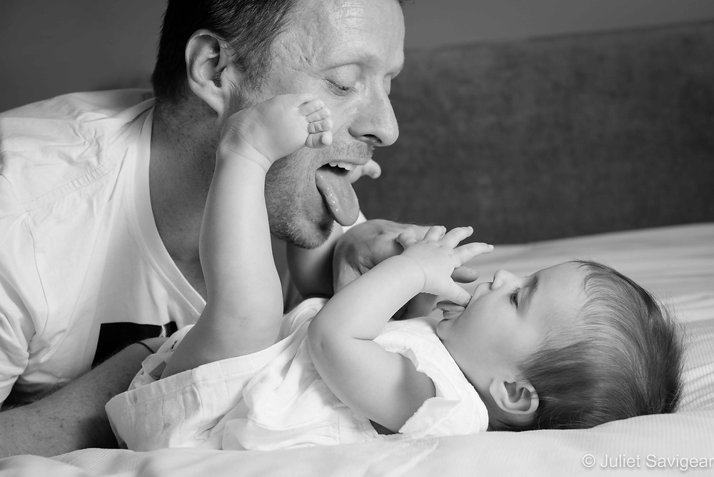 Baby playing with daddy