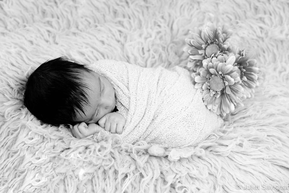 Newborn baby with flowers