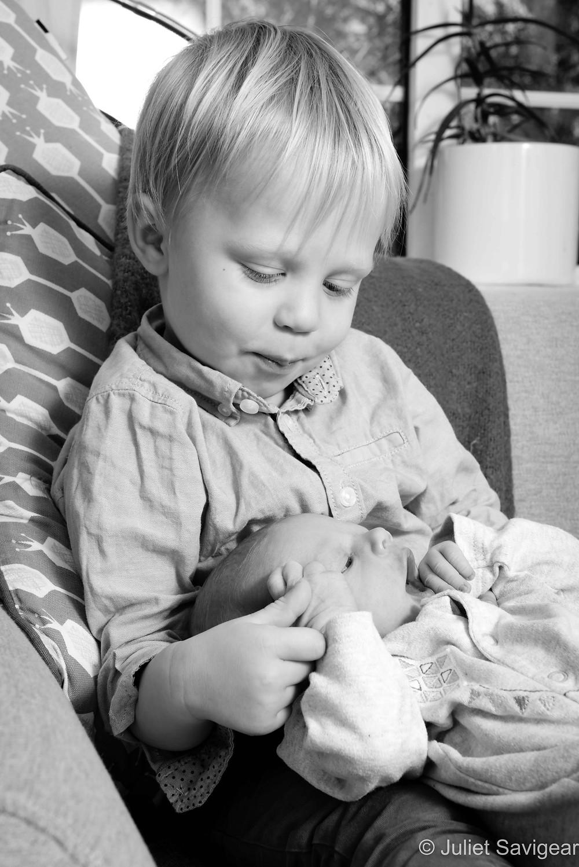 Big brother with newborn baby
